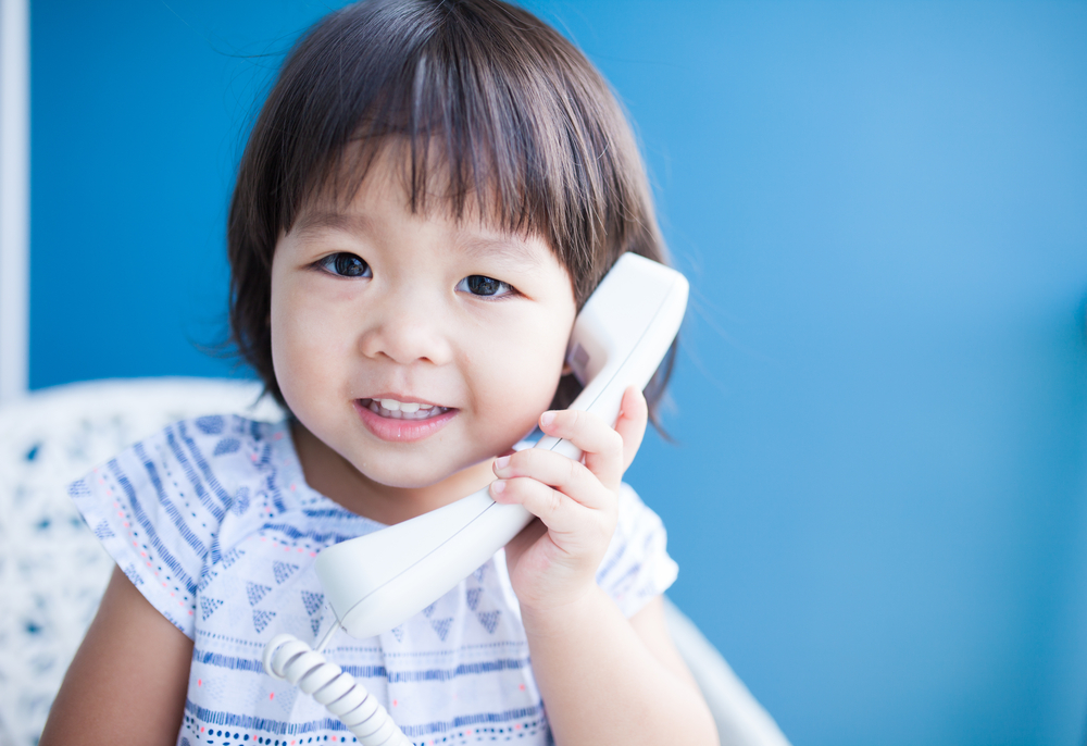 Child on telephone
